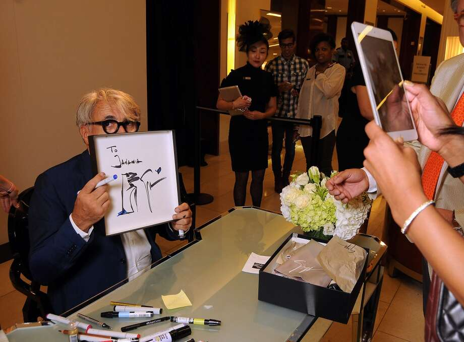 Shoe designer Giuseppe Zanotti holds up a hand-drawn design.. Photo: Dave Rossman, For The Houston Chronicle