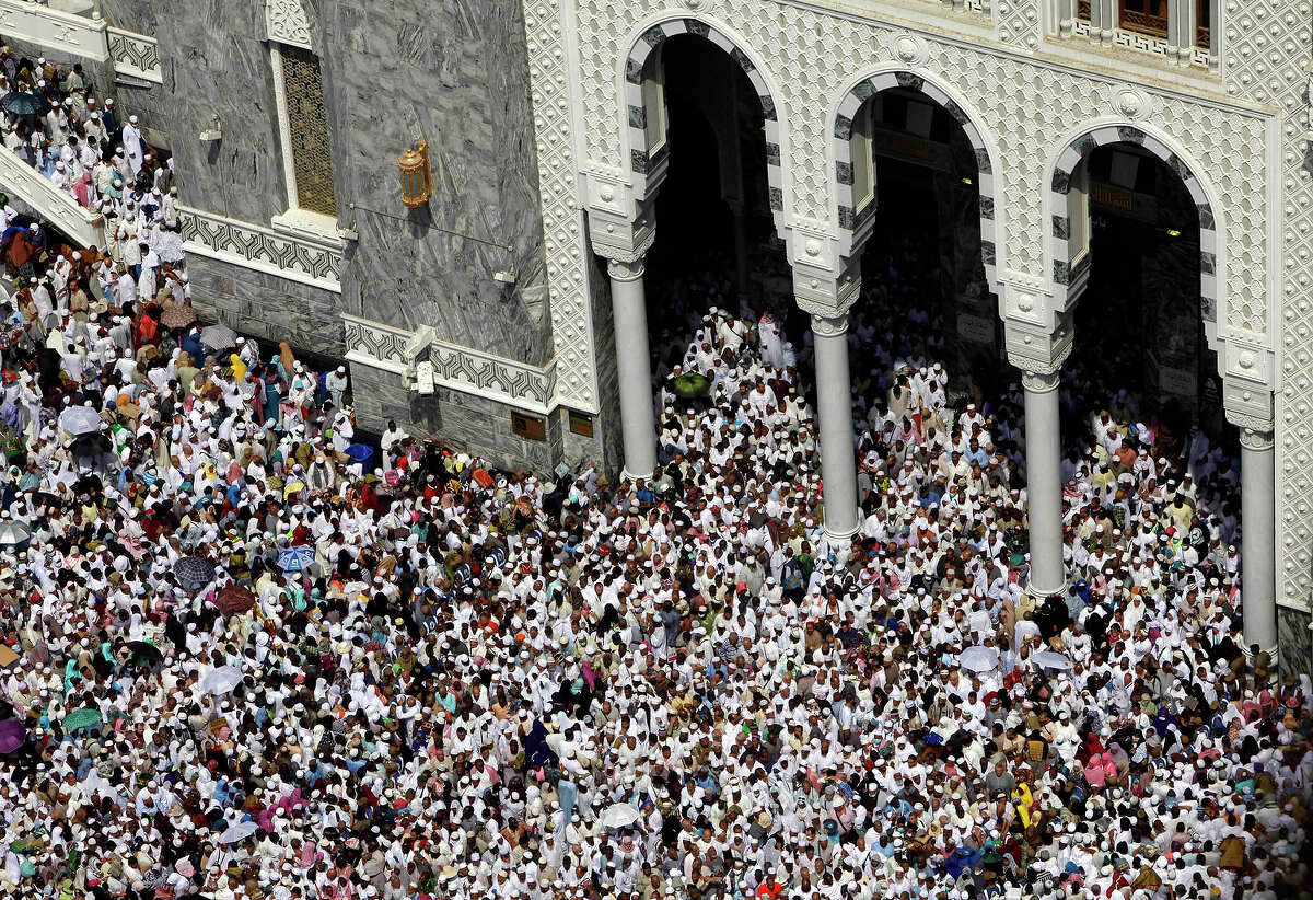 Muslim pilgrims leave Friday prayers at the Grand Mosque in the Muslim holy city of Mecca, Saudi Arabia, Friday, Oct. 11, 2013. Every Muslim is required to perform the hajj, or pilgrimage, to Mecca at least once in his or her lifetime if able to do so. (AP Photo/Amr Nabil)