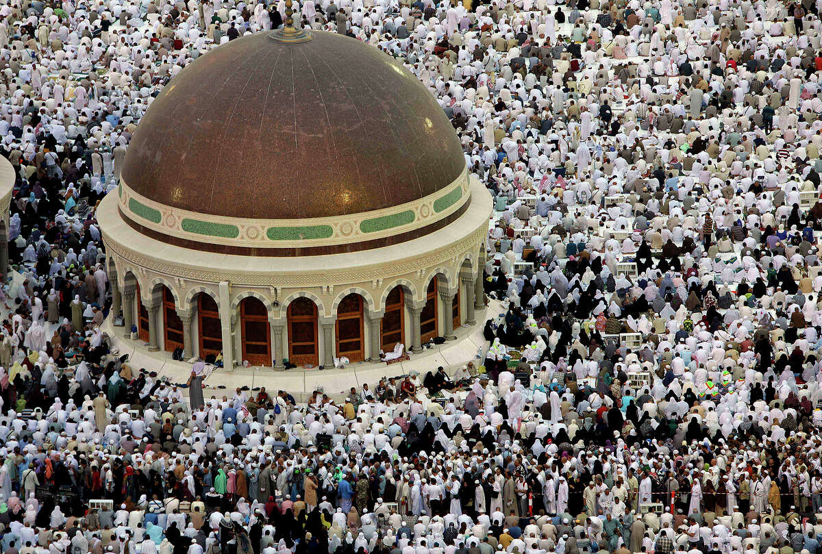 Muslim pilgrims prepare to offer prayers at sunset at the Grand Mosque in the Muslim holy city of Mecca, Saudi Arabia, Thursday, Oct. 10, 2013. Every Muslim is required to perform the hajj, or pilgrimage, to Mecca at least once in his or her lifetime if able to do so. (AP Photo/Amr Nabil)