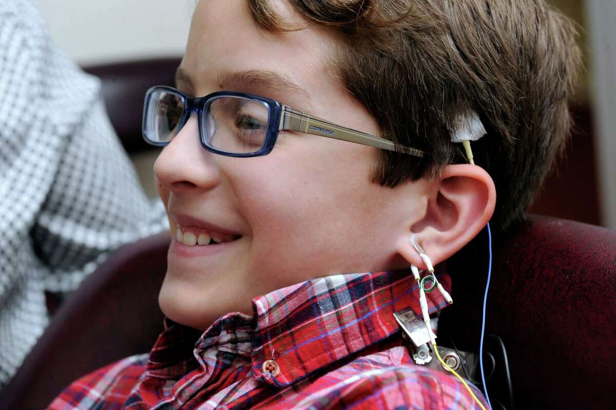 Drew Cousens, 10, of Bethel, Conn, is hooked up with sensors for his neurofeedback session with Rosann Capanna-Hodge, an educational psychologist & consultant neurofeedback practicioner in Ridgefield, Coon., Friday, Oct. 11, 2013.