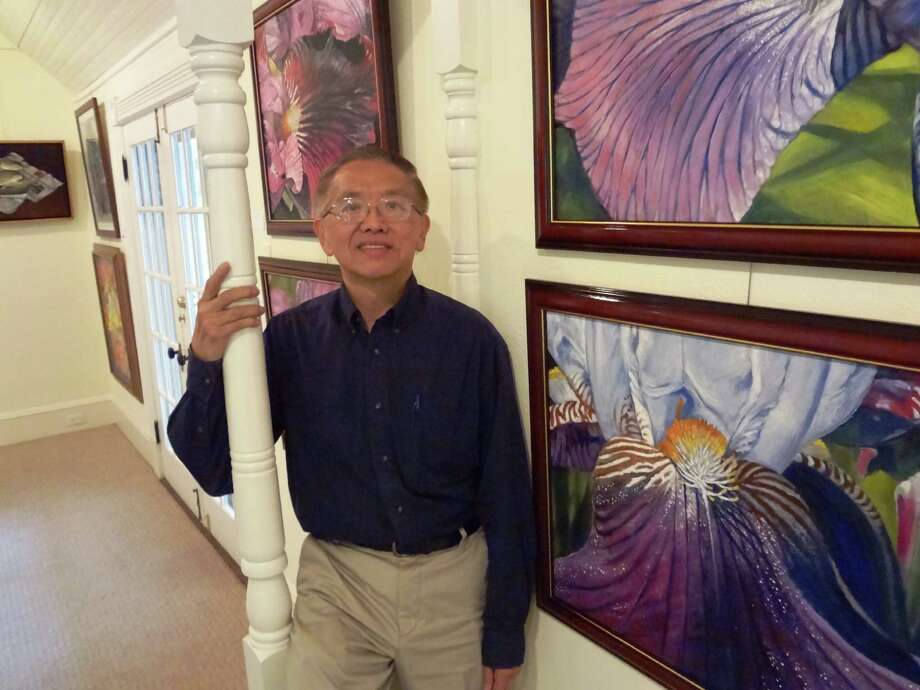 Francis Huang was honored with a retrospective exhibition for being named 2013 San Antonio Art League Artist of the Year. Photo: Steve Bennett / San Antonio Express-News