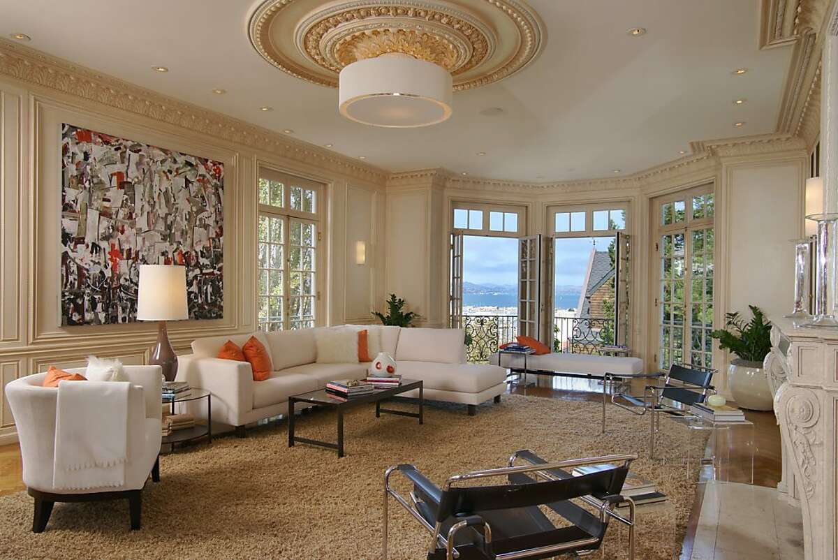 The living room includes several sets of French doors and a hardwood floor.Ê