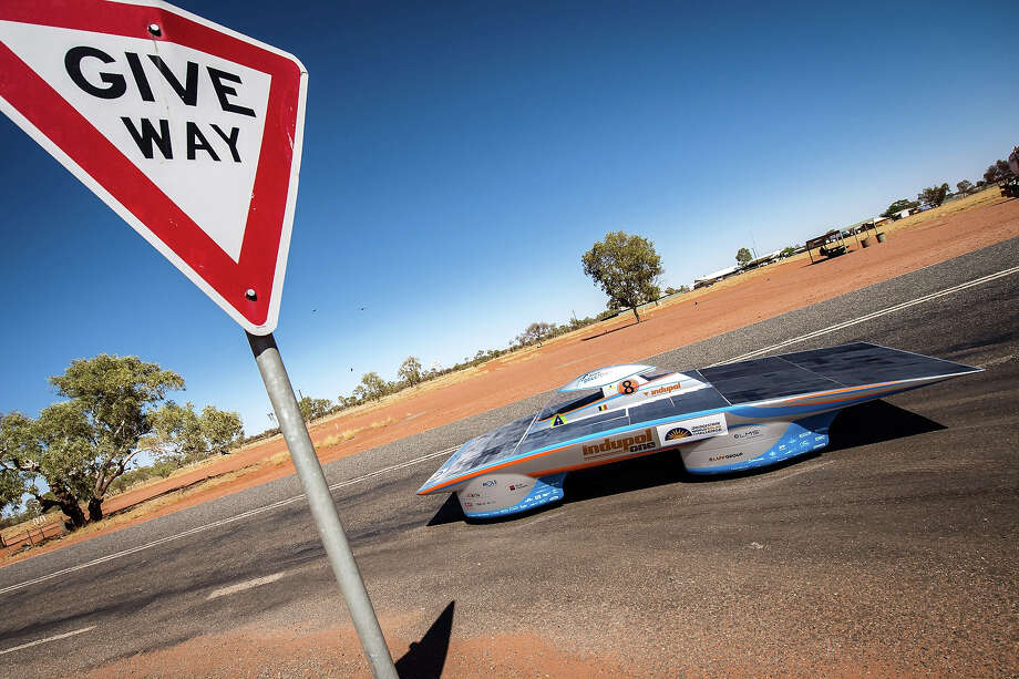 In this photo taken on Tuesday, Oct. 8, 2013, the Indupol One of the Belgian solar team leaves a control stop in Ti Tree, 191 kilometers North of Alice Springs, Australia. The solar challenge race, lasting for seven days, will take 43 participants over 3,021 kilometers before ending on Sunday, Oct 13. Photo: Geert Vanden Wijngaert, ASSOCIATED PRESS / AP2013