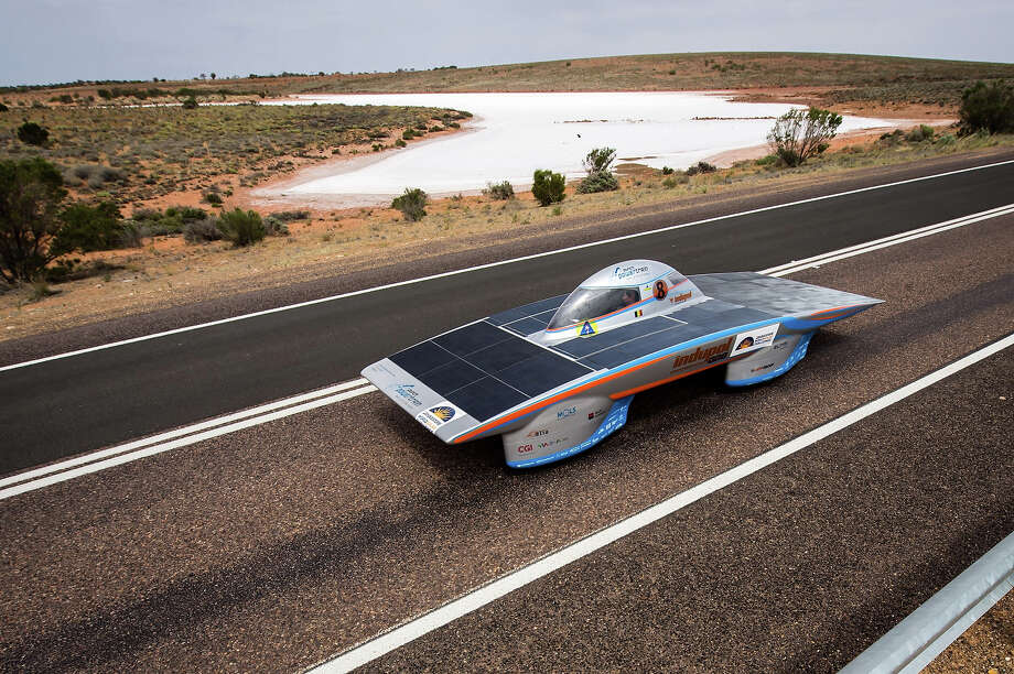 In this picture taken on Wednesday, Oct. 9, 2013 the Indupol One of the Belgian Solar Team cruises over the Stuart Highway next to a salt lake near Woomera, Australia, during the 2013 World Solar Challenge. The race, lasting for seven days, takes 43 participants over 3,021 kilometers before ending on Sunday, Oct 13. Photo: Geert Vanden Wijngaert, AP / AP