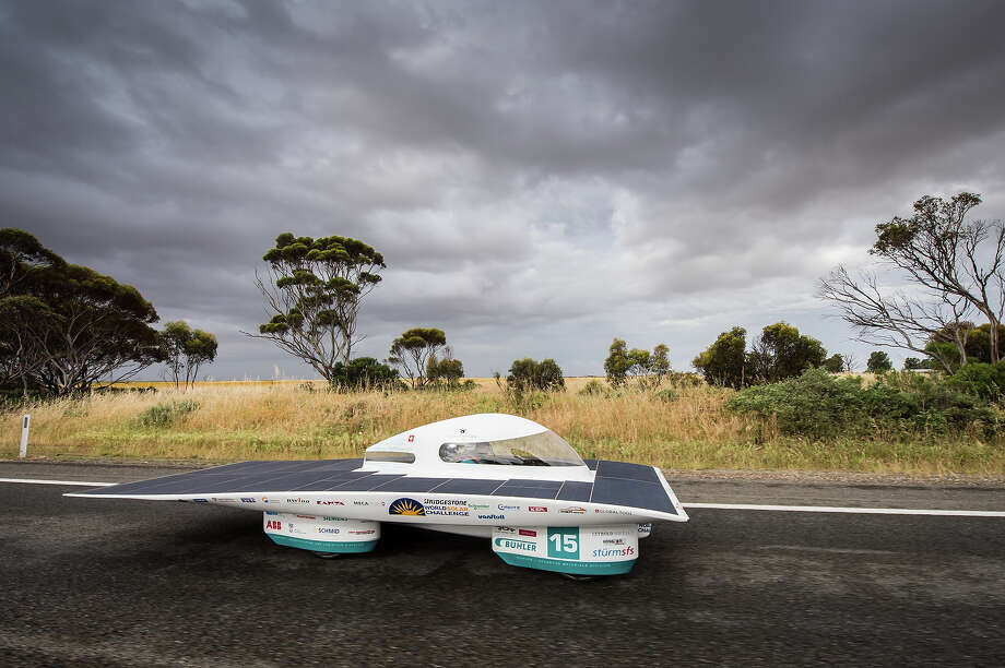 In this picture taken on Thursday, Oct. 10, 2013, The SER-2 of the Swiss solar energy race team cruises over the Stuart Highway during the 2013 World Solar Challenge 50km North of Port Augusta, Australia. The race, lasting for seven days, takes 43 participants over 3,021 kilometers before ending on Sunday, Oct 13. Photo: Geert Vanden Wijngaert, AP / AP