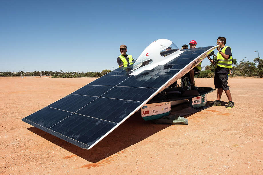 The SER-2 of the Swiss solar energy race team charges its battery pack during a control stop in Coober Pedy, Australia, on Wednesday Oct. 9, 2013. The solar challenge race, lasting for seven days, will take 43 participants over 3,021 kilometers before ending on Sunday, Oct 13. Photo: Geert Vanden Wijngaert, ASSOCIATED PRESS / AP2013