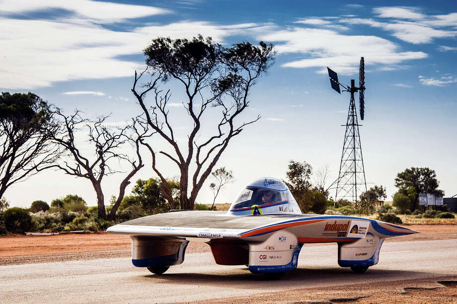 In this picture taken on Wednesday, Oct. 9, 2013 the Indupol One of the Belgian Solar Team cruises along the Stuart Highway in Glendambo, Australia, during the 2013 World Solar Challenge. The race, lasting for seven days, will take 43 participants over 3,021 kilometers before ending on Sunday, Oct 13. Photo: Geert Vanden Wijngaert, ASSOCIATED PRESS / AP2013