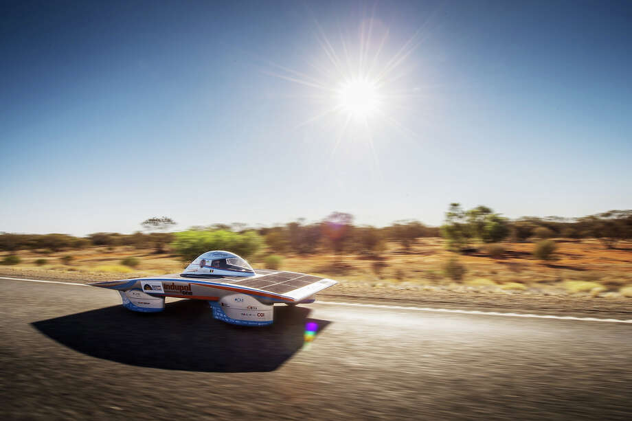 In this photo taken on Tuesday, Oct. 8, 2013, The Indupol One of the Belgian solar team rides across a desert, 285 kilometers South of Alice Springs, Australia. The solar challenge race, lasting for seven days, will take 43 participants over 3,021 kilometers before ending on Sunday, Oct 13. Photo: Geert Vanden Wijngaert, ASSOCIATED PRESS / AP2013