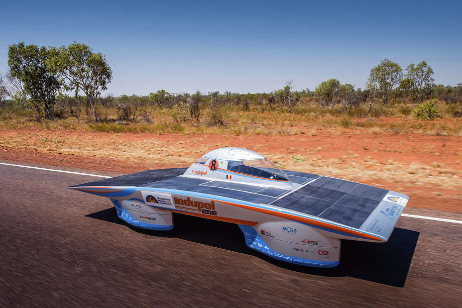 In this photo taken on Monday, Oct 7, 2013, the Belgian solar team drive their car Indupol One across the desert, near Devils Marbles approximately 400 kilometers north of Alice Springs, Australia. The  World Solar Challenge race, lasts for seven days, and will take 43 participants over 3,021 kilometers before ending on Sunday, Oct 13.  Photo: Geert Vanden Wijngaert, ASSOCIATED PRESS / AP2013