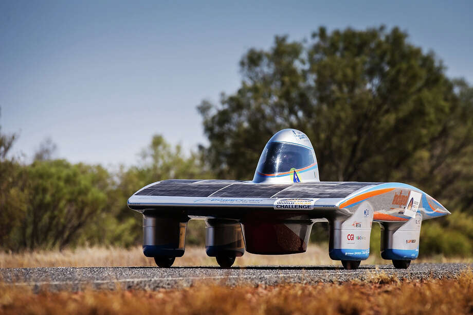 In this photo taken on Tuesday, Oct. 8, 2013, the Indupol One of the Belgian solar team drives across a desert North of Alice Springs, Australia. The solar challenge race, lasting for seven days, will take 43 participants over 3,021 kilometers before ending on Sunday, Oct 13.  Photo: Geert Vanden Wijngaert, ASSOCIATED PRESS / AP2013