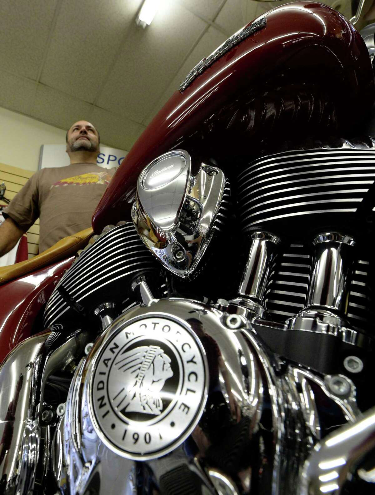 Owner Mike Menneto looks over some of the new motorcycles during the kick-off at Indian Motorcycle of Albany Friday afternoon, Oct. 11, 2013, in Clifton Park, N.Y. (Skip Dickstein / Times Union)
