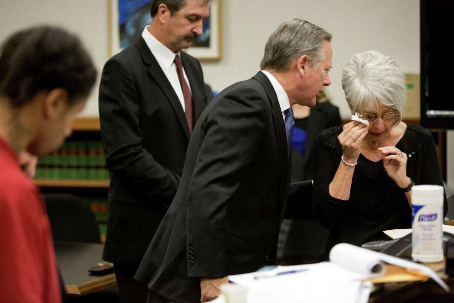 Geni Ferrari, right, mother of the late Justin Ferrari, is comforted as she reads a letter to her son's killer, Andrew Patterson, left, Friday. Patterson was sentenced to 23 years.  Photo: JORDAN STEAD, SEATTLEPI.COM / SEATTLEPI.COM