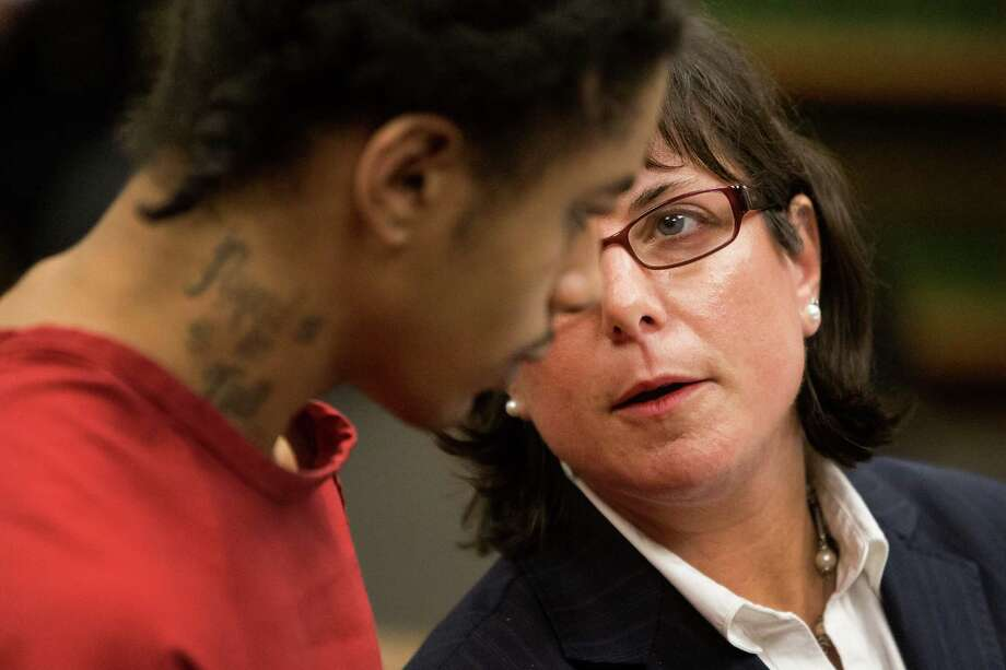 Andrew Patterson, left, speaks with his defense attorney, Aimee Sutton, right, during his sentencing Friday for the 2012 murder of Justin Ferrari. Photo: JORDAN STEAD, SEATTLEPI.COM / SEATTLEPI.COM