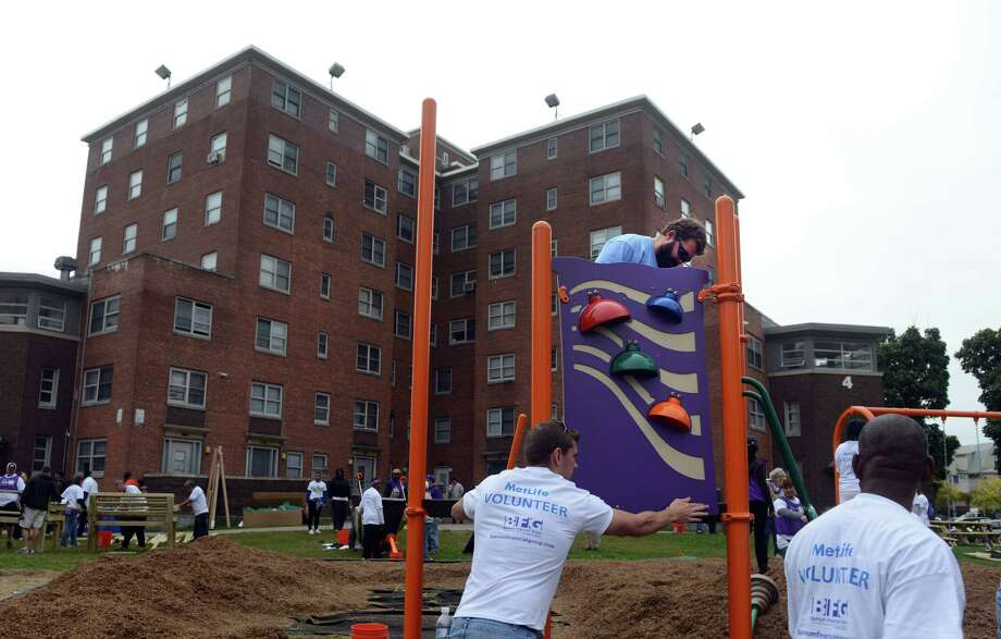 Jose Ferreira, Ultiplay foreman, leads the construction of a new playground at Charles F. Greene Homes in Bridgeport, Conn. Friday, Oct. 11, 2013.   More than 200 volunteers from MetLife Foundation, Barnum Financial Group, An Office of MetLife, the Housing Authority of the City of Bridgeport, organizers from KaBOOM! and city residents came together to construct the play space that will serve over 400 children. Photo: Autumn Driscoll / Connecticut Post