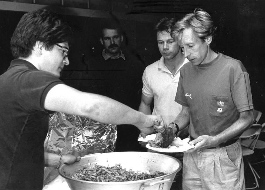 Kevin O'Brian serves up pasta to marathon star Bill Rodgers on Oct. 15, 1988, the night before the Stamford Classic Marathon. Photo: File Photo, Advocate / Advocate