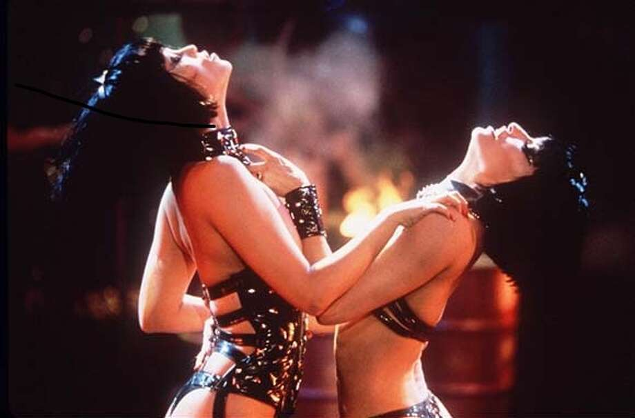 """Showgirls"" (cacoarock):  OK, I agree it's bad.  But must NOT see?  I've seen this six times!  It keeps getting worse, which makes it only better."
