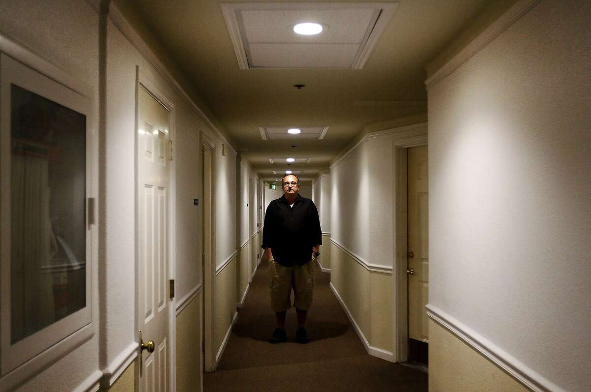 Ben Cady, one of the tenants being evicted from 1049 Market St., is photographed in the hallway of the building in San Francisco, Calif., on Thursday, October 10, 2013. The building, which houses many artists, is evicting the tenants because some of the units do not have windows and therefore are not legal.