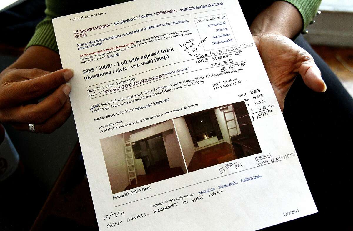 Melissa Bracero, a tenant at 1049 Market St., shows the original posting where she found her unit advertised under 'apartments and housing for rent' in her unit in the building in San Francisco, Calif., on Thursday, October 10, 2013. The building, which houses many artists, is evicting the tenants because some of the units do not have windows and therefore are not legal.