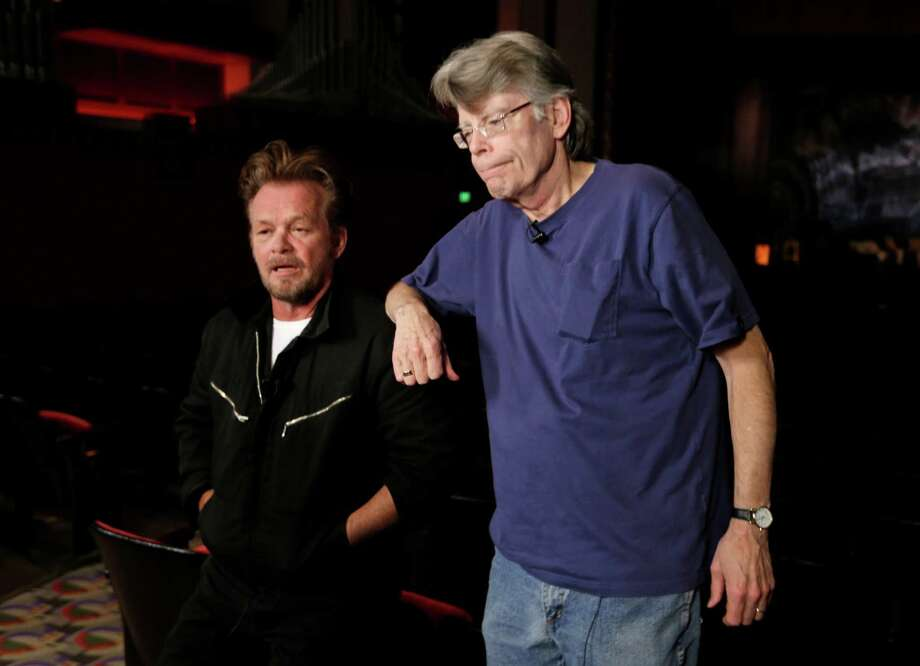 "This Tuesday, Oct. 8, 2013 photo shows musician John Mellencamp, left, and writer Stephen King at a press preview of the musical ""Ghost Brothers of Darkland County"" at the Indiana University Auditorium in Bloomington, Ind. The musical by Mellencamp, King and T Bone Burnett will debut in Bloomington on Thursday before embarking on a tour of 20 U.S. cities. (AP Photo/Michael Conroy) Photo: Michael Conroy, STF / AP"