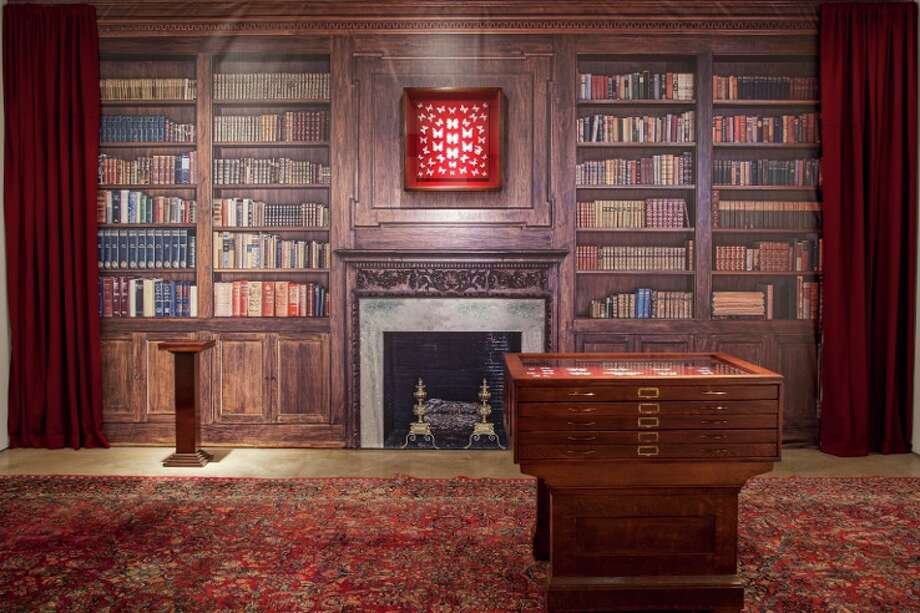 """Michael Crowder's exhibit """"Retro-spectacle"""" transforms Wade Wilson Art into a 19th century """"home"""" complete with curiosity cabinets full of exquisite cast glass butterflies. Photo: David A. Brown / ONLINE_YES"""