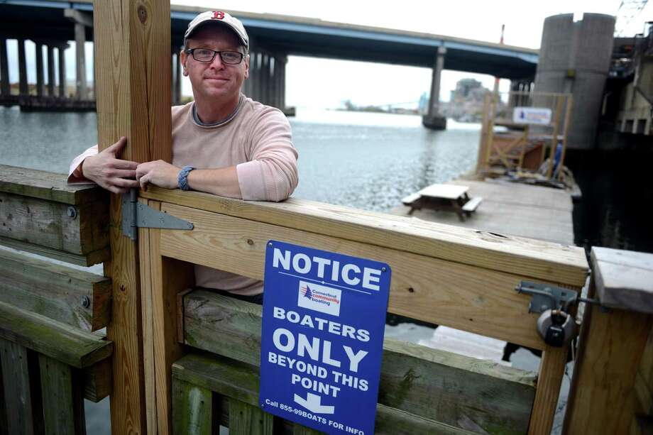 Chris German, of Connecticut Community Boating, stands in front of the non-profit's docks behind the Bridgeport train station.  The city has removed the group's boats and is threatening to take the docks. Photo: Autumn Driscoll / Connecticut Post