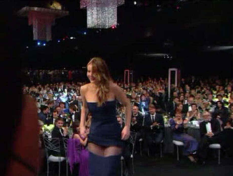 Did Jennifer Lawrence mean to show so much thigh while accepting a SAG award January 27, 2013? Photo: (TNT Screen Grab)
