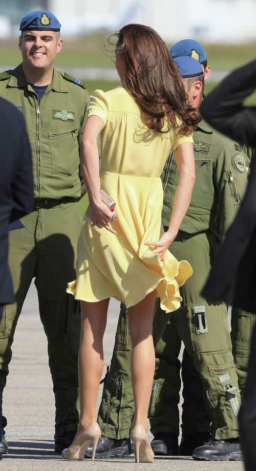Catherine, Duchess of Cambridge, holds her dress down while speaking to soldiers at the Calgary Airport. Photo: Chris Jackson, Getty Images / 2011 Getty Images