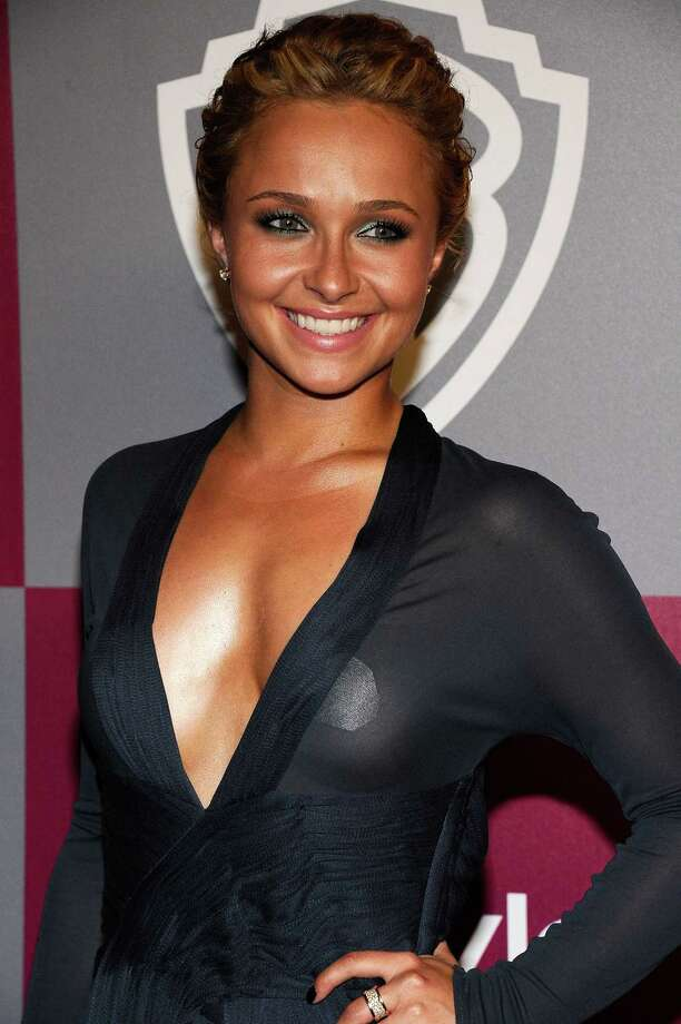 Hayden Panettieretries to cover up in a sheer outfit - or not? - at a Golden Globes party. Photo: Kevork Djansezian, Getty Images / 2011 Getty Images