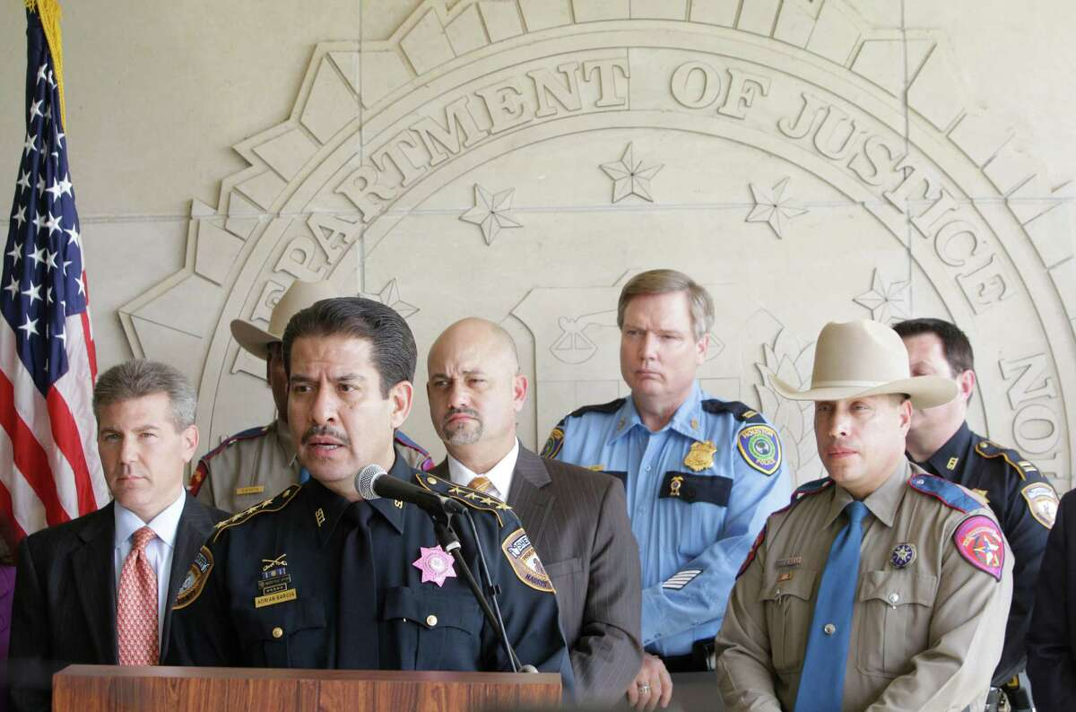 Harris County Sheriff Adrian Garcia, center left, speaks during media conference at FBI Houston Headquarters, 1 Justice Park Drive, Friday, Oct. 11, 2013, in Houston. The multi-agency media conference was held to announce multiple federal arrests, and to seek public assistance in the ongoing investigation of an international sex-trafficking ring in which 14 have been charged. Twelve victims were recovered including five minors.