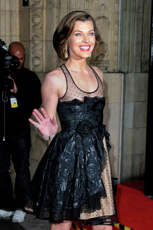 Milla Jovovichwears a sheer, low-cut dress that didn't quite cover her up at a concert at the Royal Albert Hall to celebrate the 80th birthday of the former Soviet leader Mikhail Gorbachev. Photo: Eamonn McCormack, Getty Images / 2011 Getty Images