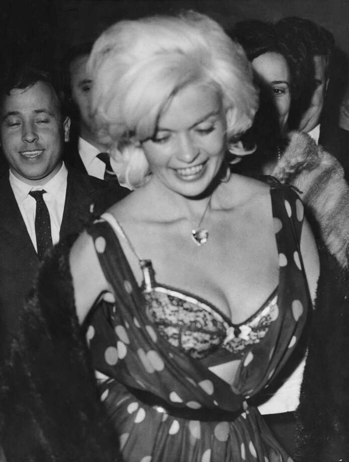 "Wardrobe malfunctions apparently were happening decades ago. Who believes Jayne Mansfield busting out of her dress in 1962 while clubbing in Rome was an ""accident?"" (Photo by Keystone/Hulton Archive/Getty Images) Photo: Keystone, Getty Images / 2010 Getty Images"