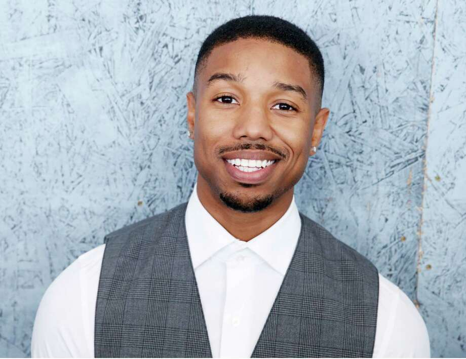 "FILE - In this May 16, 2013 file photo, actor Michael B. Jordan, from the film ""Fruitvale Station,"" poses at the 66th international film festival, in Cannes, southern France. The 26-year-old actor is in discussions for key roles in several big-budget studio movies after his star turn in this summer's indie ""Fruitvale Station,"" which won both jury and audience awards at the Sundance Film Festival. His role as Oscar Grant, killed by transit police in 2009 at an Oakland train station, is expected to lead to acting honors as Hollywood's movie awards season begins in coming months.  (Photo by Todd Williamson/Invision/AP, File) ORG XMIT: NYET406 Photo: Todd Williamson / Invision"