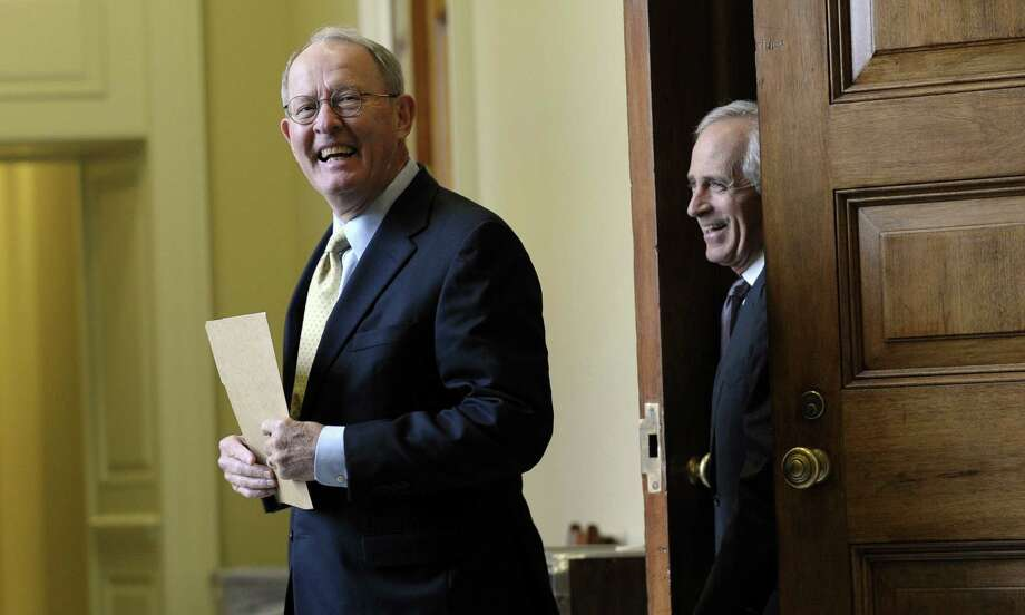 A reader praises Sen. Lamar Alexander, R-Tenn. (left), for asking his GOP colleagues how they would react if it was the Democrats who insisted they would not finance the government for political reasons. Photo: Susan Walsh / Associated Press