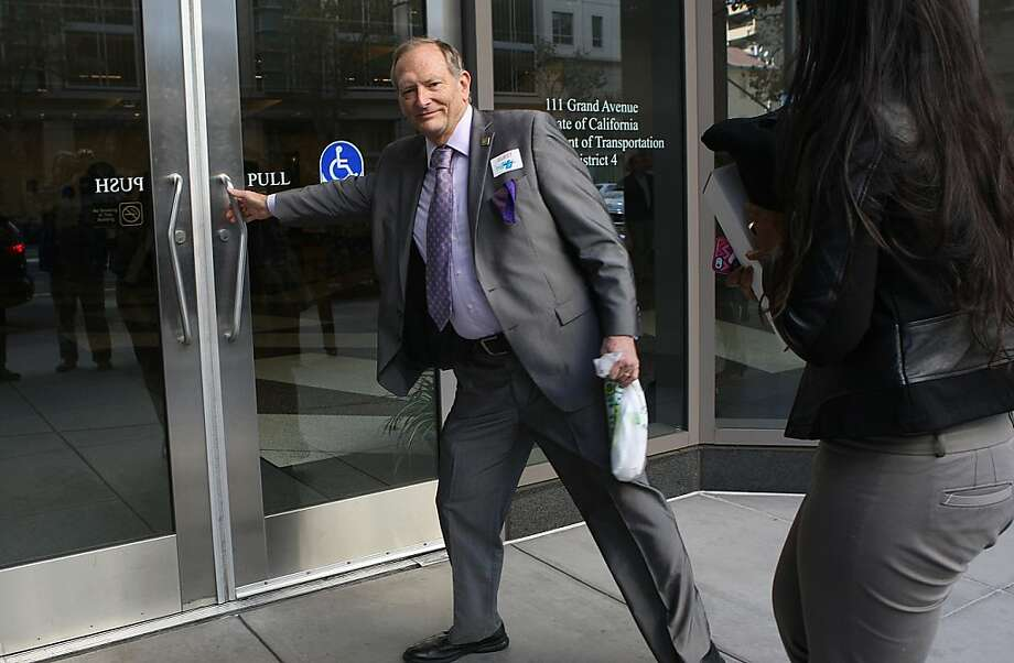 Assembly member Bill Quirk (D-Hayward) re-enters the building where Bart management and union leaders are at the bargaining table this morning in Oakland, California, on Friday, October 11, 2013.  He took a break for lunch to get a Subway sandwich. Photo: Liz Hafalia, The Chronicle