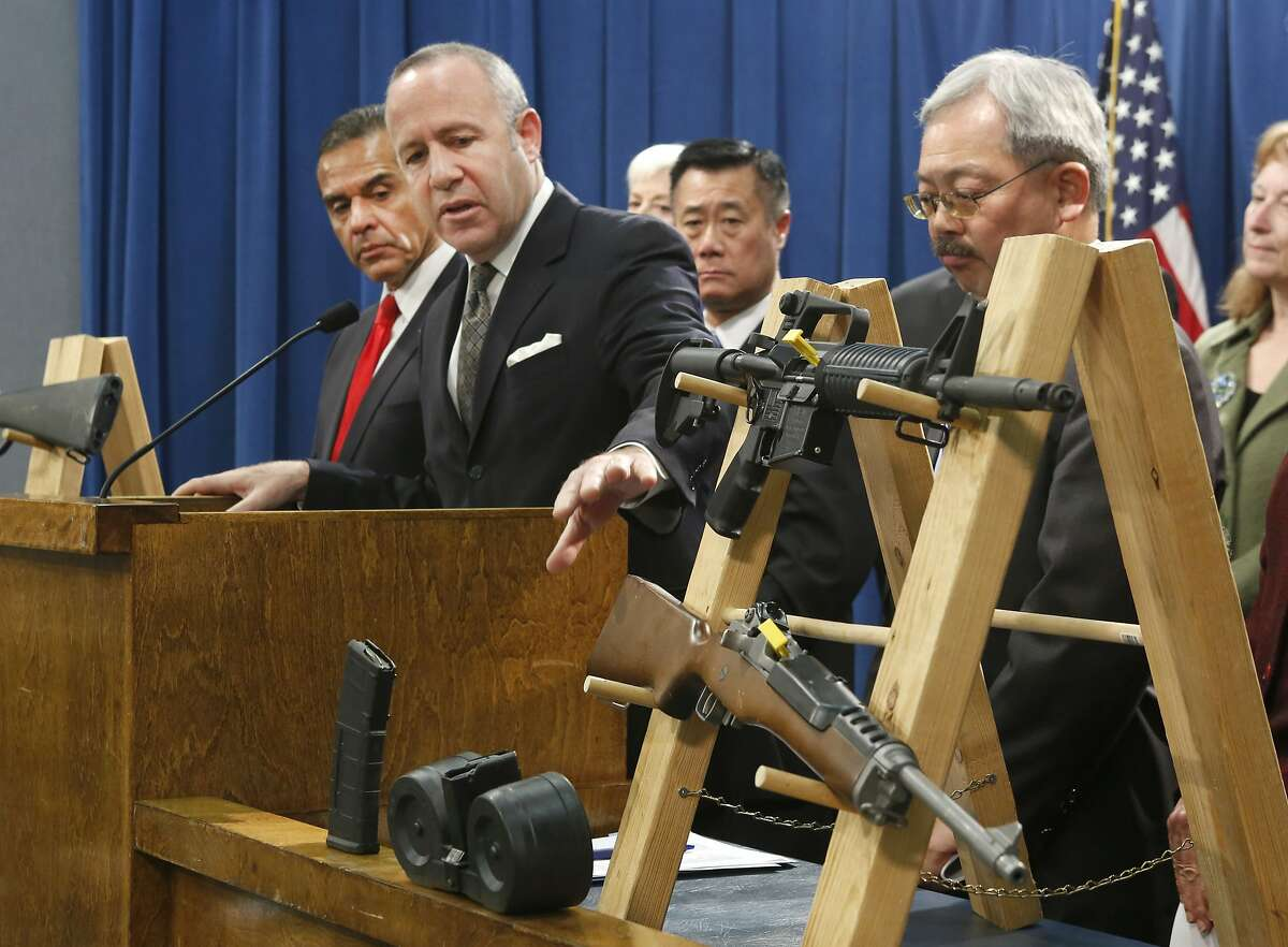 In this Feb. 7, 2013 file photo, Senate President Pro Tem Darrell Steinberg, second from left, gestures to a pair of semi-automatic rifles as he discusses a package of proposed gun control legislation at a Capitol news conference in Sacramento, Calif. Gov. Jerry Brown vetoed Steinbergs's SB374 which would have banned future sales of most semi-automatic rifles that accept detachable magazines, Friday, Oct. 11, 2013.(AP Photo/Rich Pedroncelli,File)