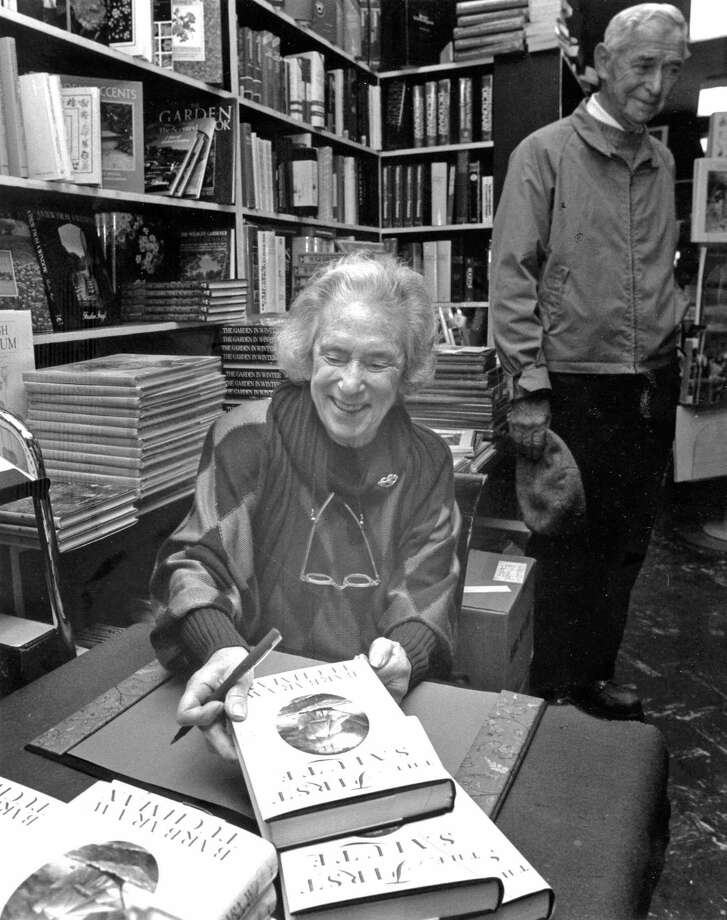"Historian and Cos Cob resident Barbara Tuchman autographs copies of her book ""The First Salute"" at Just Books on East Putnam Avenue on Oct. 19, 1988. Photo: File Photo, Greenwich Time / Greenwich Time"