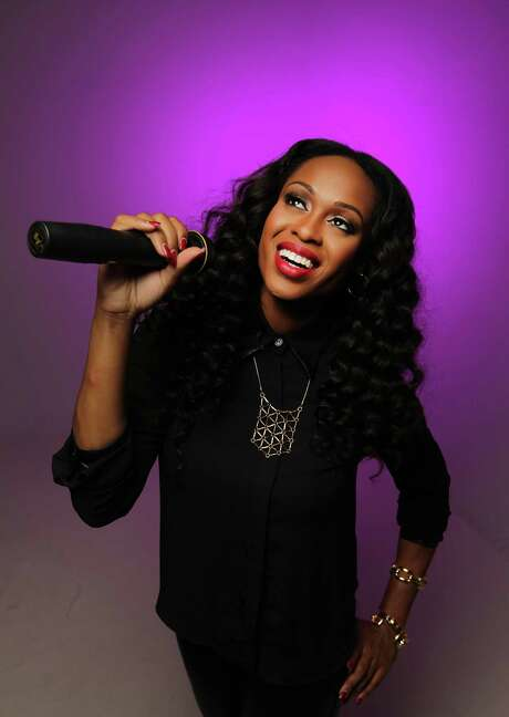 Houston singer Love Dominique poses for a portrait, Dominique is releasing a new EP this week Thursday, Sept. 5, 2013, in Houston.  ( James Nielsen / Houston Chronicle ) Photo: James Nielsen, Staff / © 2013  Houston Chronicle