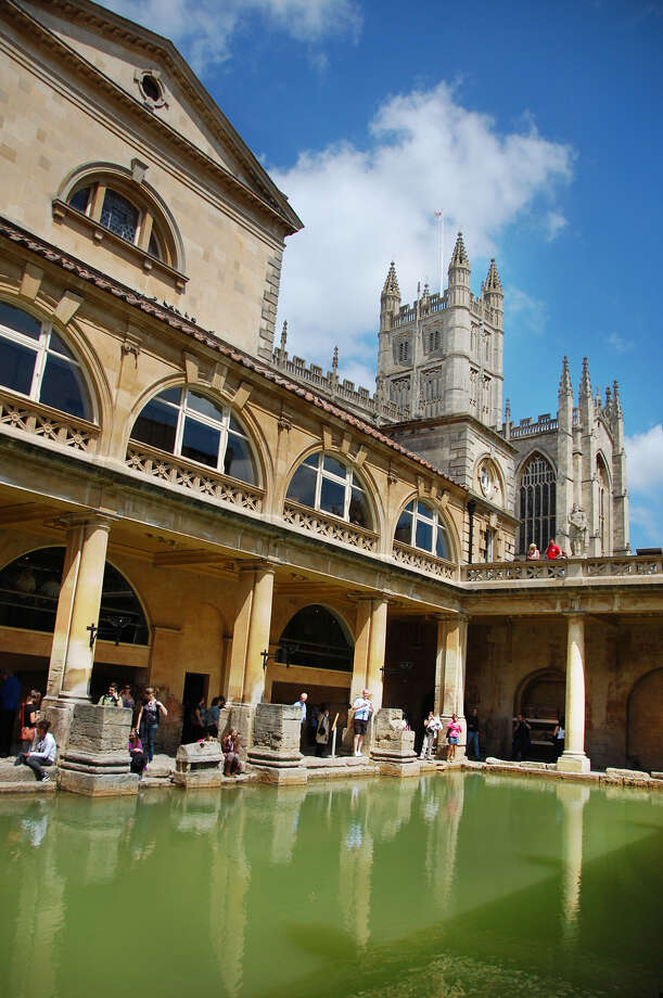 The Great Bath, fed with hot spring water, was perfect for a luxurious swim in Roman times (notice Bath's abbey in the distance). (photo: Cameron Hewitt) Photo: Ricksteves.com