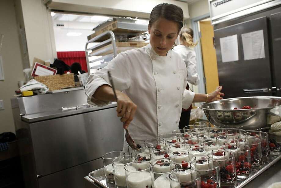 Chef Jenna Savage prepares fruit and yogurt as part of the Conscious Kitchen project at a high-poverty school. Photo: Lacy Atkins, The Chronicle