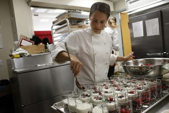 Chef Jenna Savage make mixed food and yogurt as a part of the Conscious Kitchen Project  for  visitors and students at Martin Luther King Academy, Wednesday September 11, 2013, in Marin City, Calif. The Conscious Kitchen project is chefs from across the Bay Area working with the schools to create healthier meals for the low-income communities.