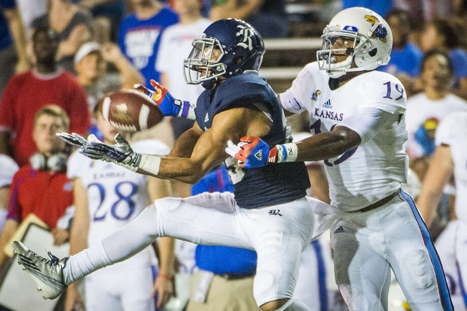 Rice cornerback Bryce Callahan (left) intercepts a pass intended for Kansas wide receiver Justin McCay during the first half of the Owls' 23-14 non-conference victory at Rice Stadium in Houston on Sept. 14. Photo: Smiley N. Pool / Houston Chronicle