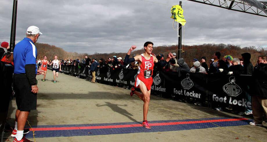Fairfield Prep's Christian Alvarado crosses the finish line eighth at the Foot Locker Northeast Regional Championships on Nov. 17 at Van Cortlandt Park in New York. Photo: Contributed Photo / Fairfield Citizen