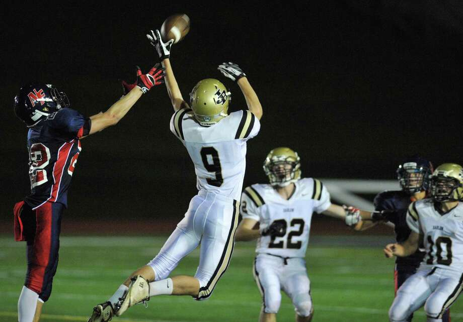 New Fairfield's Collin Cioffi, left, and Joel Barlow's Bryan Gallaer jumps to catch a pass in the SWC high school football game between New Fairfield and Joel Barlow at New Fairfield High School in New Fairfield, Conn. on Friday, Oct. 11, 2013. Photo: Tyler Sizemore / The News-Times