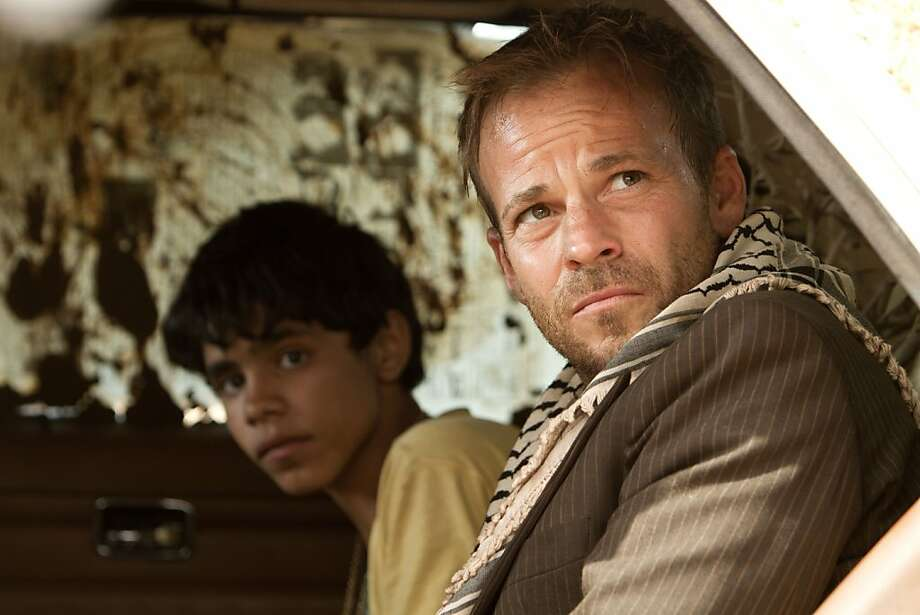 """Stephen Dorff plays an Israeli fighter pilot who is shot down and gets help from a Palestinian boy (Abdallah El Akal) in """"Zaytoun."""" Photo: Strand Releasing"""