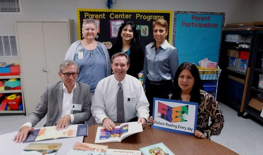 Visiting experts and Fort Bend ISD personnel discuss Fathers Reading Every Day programs. Seated, from left, Charlie Rice, Stephen Green and Gabriela Escobedo; back row, Amanda Hartley, Priti Avntsa and Rebeca Bangstein. Photo: Provided By Fort Bend Independent School District