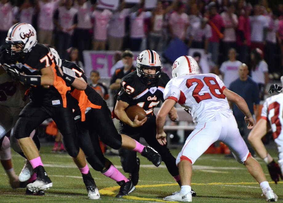 Shelton's quarterback Mark Piccirillo (12) carries the ball during the football game against Fairfield Prep at Shelton High School on Friday, Oct. 11, 2013. Photo: Amy Mortensen / Connecticut Post Freelance