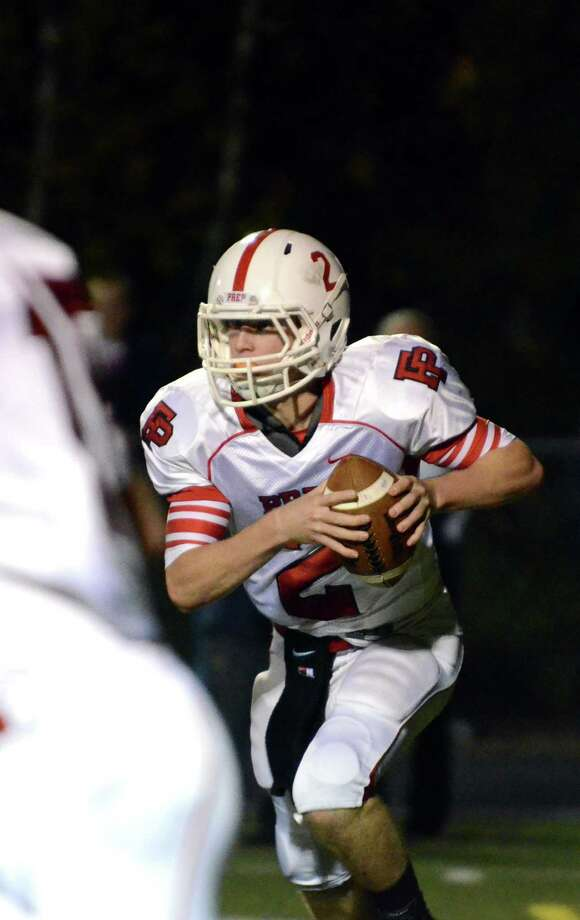 Fairfield Prep's quarterback Colton Smith (2) carries the ball during the football game against Shelton at Shelton High School on Friday, Oct. 11, 2013. Photo: Amy Mortensen / Connecticut Post Freelance