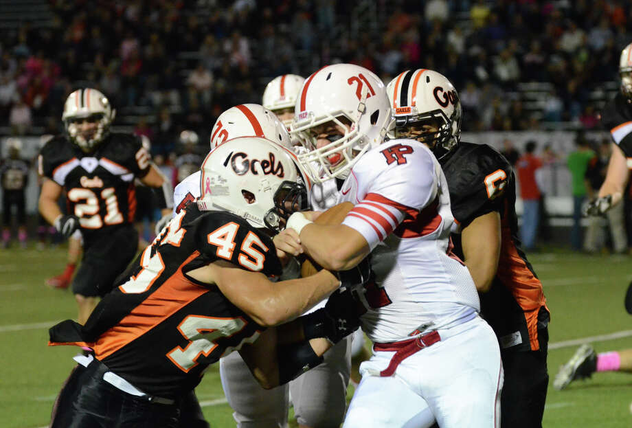 Fairfield Prep's Andrew Vegliante (21) carries the ball as Shelton's Michael Ortoli (45) defends during the football game at Shelton High School on Friday, Oct. 11, 2013. Photo: Amy Mortensen / Connecticut Post Freelance