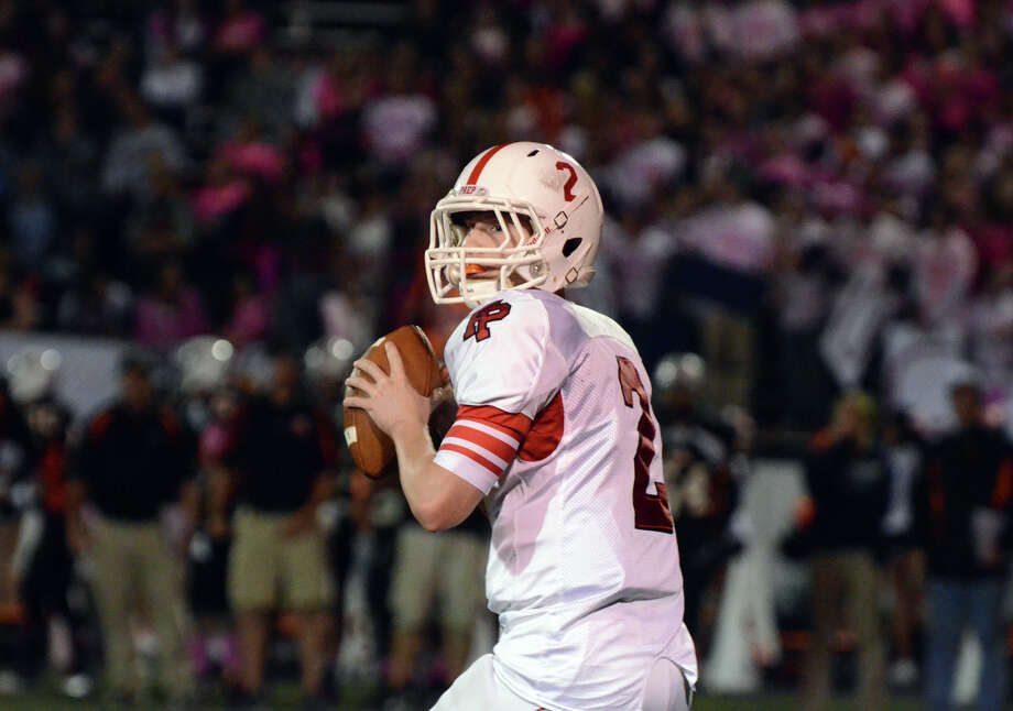 Fairfield Prep's quarterback Colton Smith (2) looks to pass during the football game against Shelton at Shelton High School on Friday, Oct. 11, 2013. Photo: Amy Mortensen / Connecticut Post Freelance