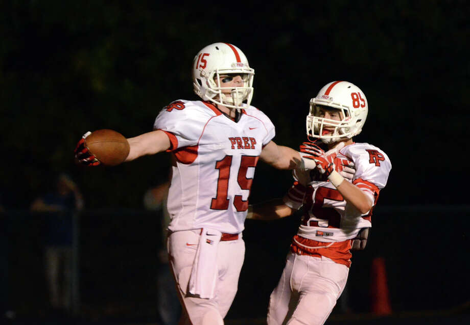 Fairfield Prep's John DelliSanti (15) celebrates a touchdown in the endzone with teammate Brendan Beiser (85) during the football game against Shelton at Shelton High School on Friday, Oct. 11, 2013. Photo: Amy Mortensen / Connecticut Post Freelance